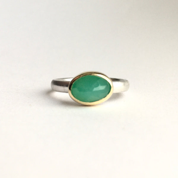 Front view of faceted chrysoprase set in 18 ct gold on a oval silver ring by Michele Wyckoff Smith on www.wyckoffsmith.com