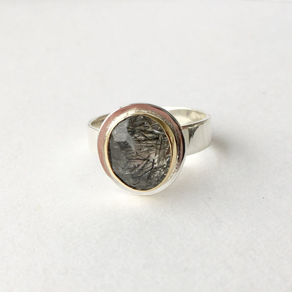 Rutilated quartz ring with silver and gold by www.wyckoffsmith.com.