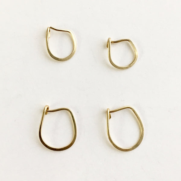 14 ct yellow gold hoop earrings (upper left is open) by Wyckoff Smith Jewellery