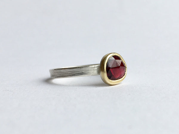 Side view of rose cut faceted garnet set in 18 ct gold on a silver ring by Michele Wyckoff Smith