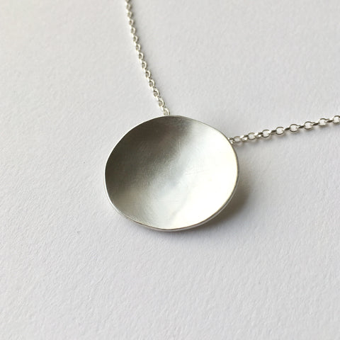 Organic shape oval silver pendant by Michele Wyckoff Smith
