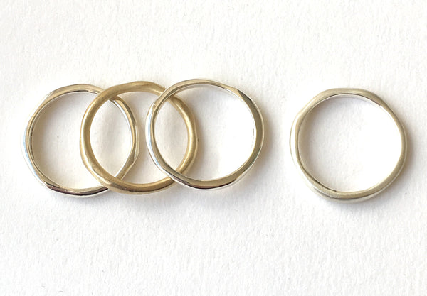 Organic shaped stacking silver and gold rings by Wyckoff Smith Jewellery