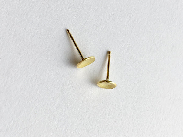 Top view of domed 18 ct gold stud earrings by Wyckoff Smith Jewellery