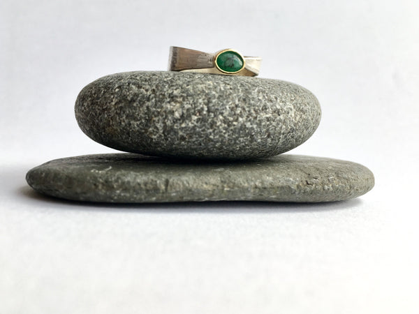 Affordable emerald ring on perched on two pebbles by Michele Wyckoff Smith
