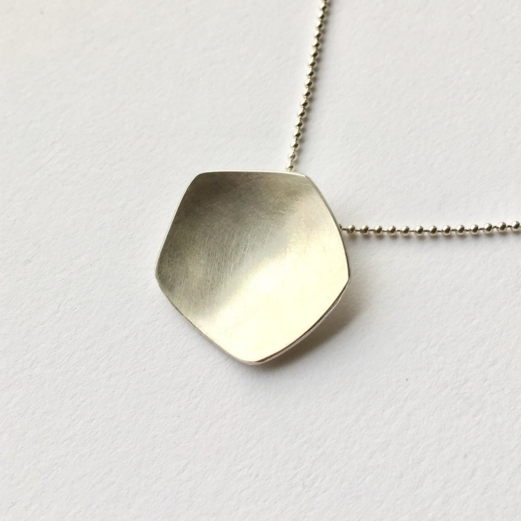 Calyx silver pendant inspired by the poppy by Michele Wyckoff Smith