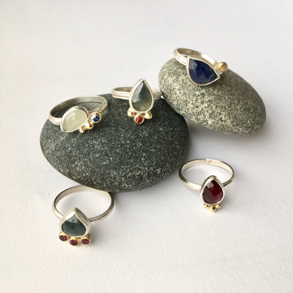 Assortment of rough luxe garnet and sapphire rings by Michele Wyckoff Smith