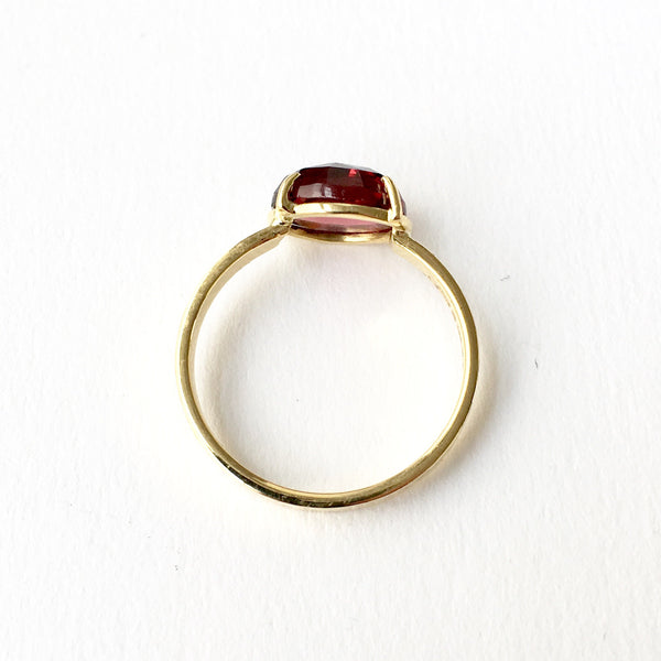 www.WyckoffSmith.com garnet and 18 ct gold ring with texture.