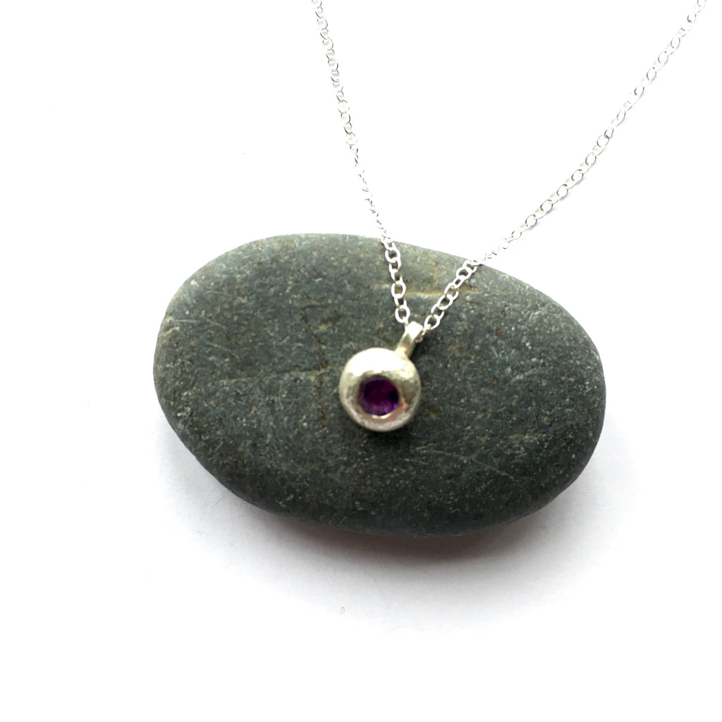 Amethyst gemstone pendant set in recycled silver ball on www.wyckoffsmith.com