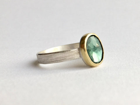 Rose cut blue tourmaline set in 18 ct gold on textured silver ring by Michele Wyckoff Smith