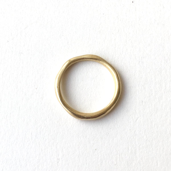 The perfect narrow organic shaped wedding band by Wyckoff Smith Jewellery