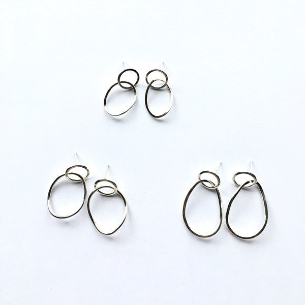 Three sizes of Silver Twisted Petal Stud Earrings on www.wyckoffsmith.com