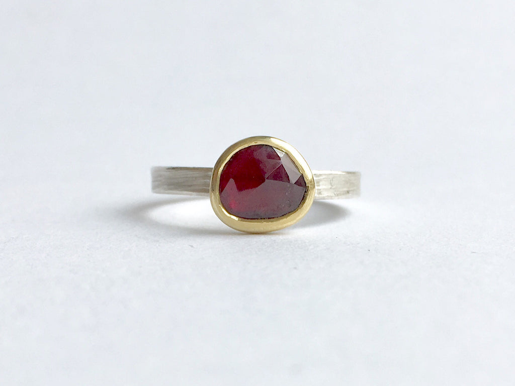 Faceted rose cut garnet set in 18 ct gold bezel on a silver ring by Michele Wyckoff Smith