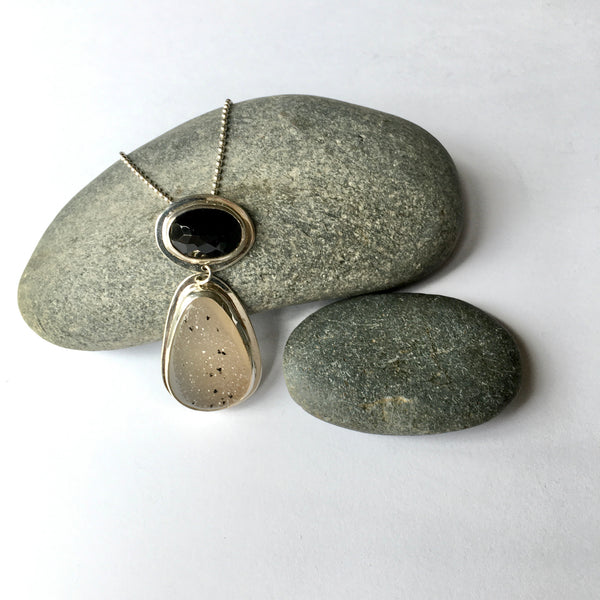 Black onyx and speckled white druzy pendant on www.wyckoffsmith.com