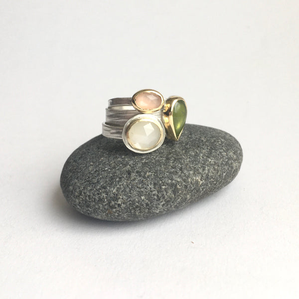 Stack of three gemstone rings on www.wyckoffsmith.com top to bottom: peach moonstone, green idiocrase and white moonstone