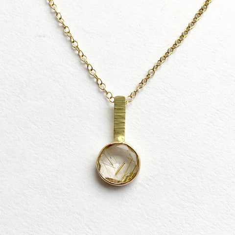 Rutilated quartz pendant on adjustable 18 ct gold chain by Wyckoff Smith Jewellery