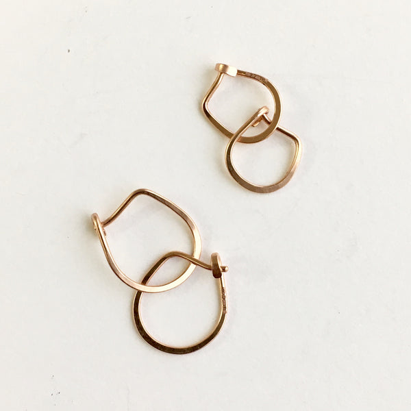 14 ct rose gold hammered hoops by Wyckoff Smith Jewellery
