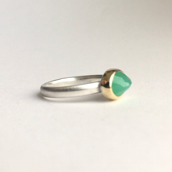 Side view of faceted chrysoprase set in 18 ct gold on a silver ring available on www.wyckofsmith.com