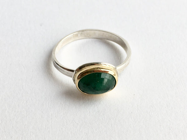 Top view of silver and gold emerald ring with inclusions by Michele Wyckoff Smith