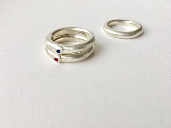 Chunky organic shaped curved wedding rings with ruby or sapphires. Michele Wyckoff Smith Jewellery