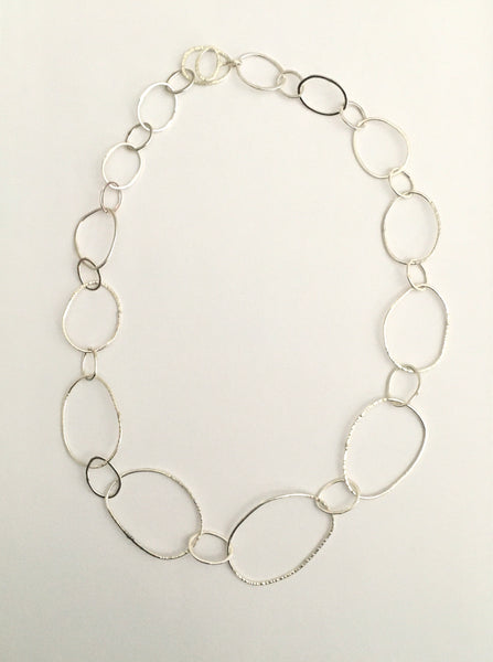 Long view of organic shaped silver pebble chain on www.wyckoffsmith.com