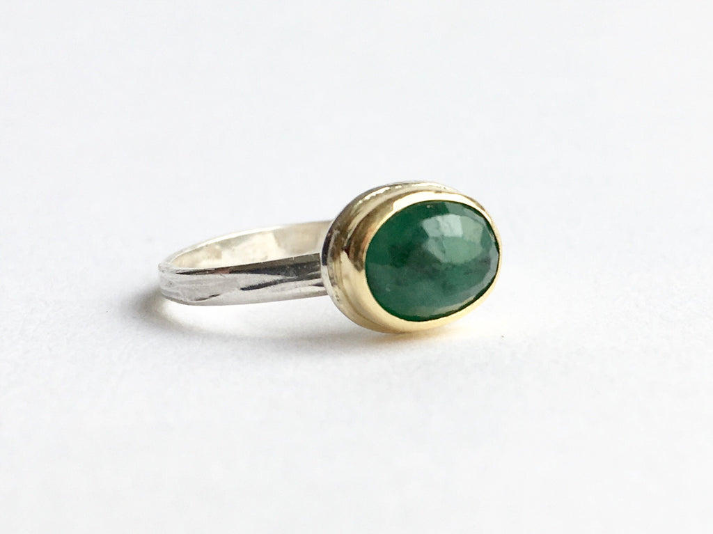 Emerald ring set in 18 ct gold on silver band by Wyckoff Smith Jewellery (UK)