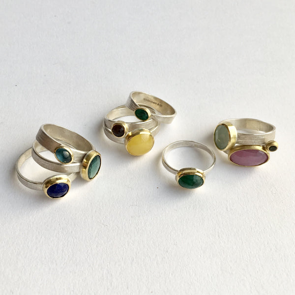 Assorted silver, gold and gemstone stacking rings by Michele Wyckoff Smith Jewelry