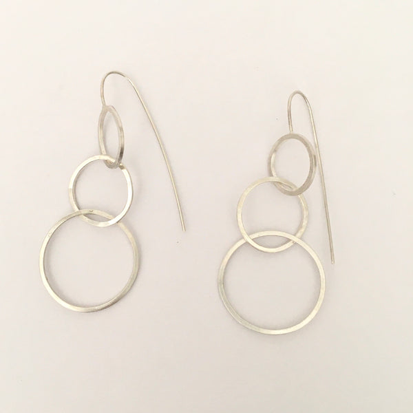 Three intertwined silver circle dangle earrings on www.wyckoffsmith.com