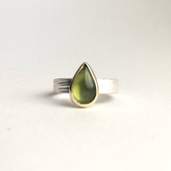 Front view of a green pear shaped indiocrase stacking ring. Silver and gold ring on www.wyckoffsmith.com