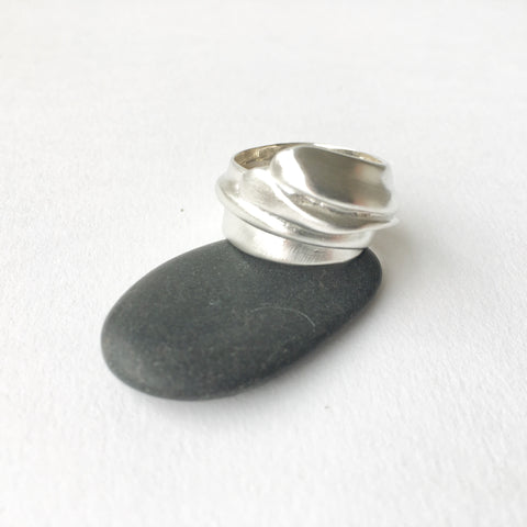 Graceful cast silver wrap ring by Michele Wyckoff Smith.