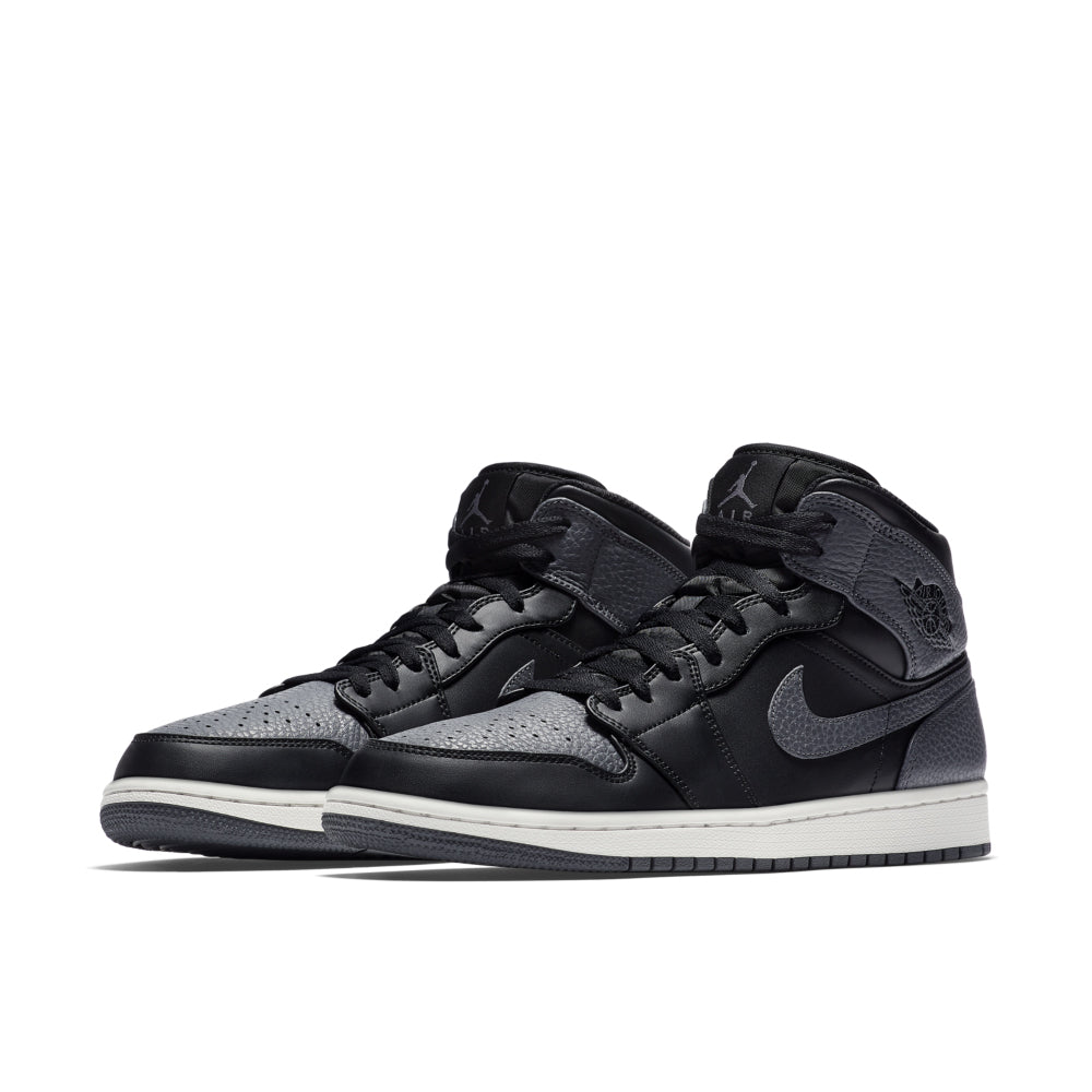 a94c1f1bd8d342 The Air Jordan 1 Mid Men s Shoe draws heritage style from the  85 AJ1  original. Featuring leather and an Air-Sole unit for lasting comfort and an  elevated ...