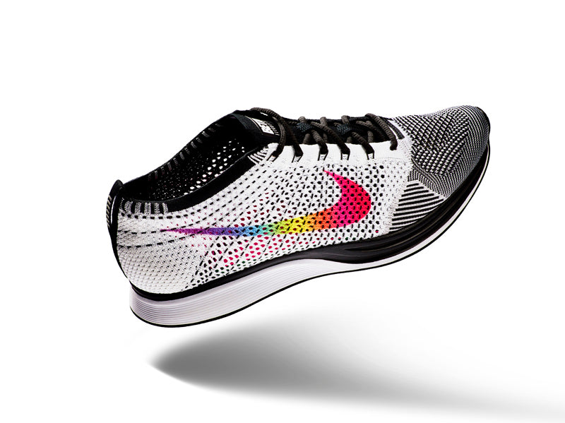 dfca18a7be ... smooth, HD gradient, Nike designers achieved the first-ever  eight-color, rainbow Swoosh design on the lateral side of the black and  white Flyknit Racer.