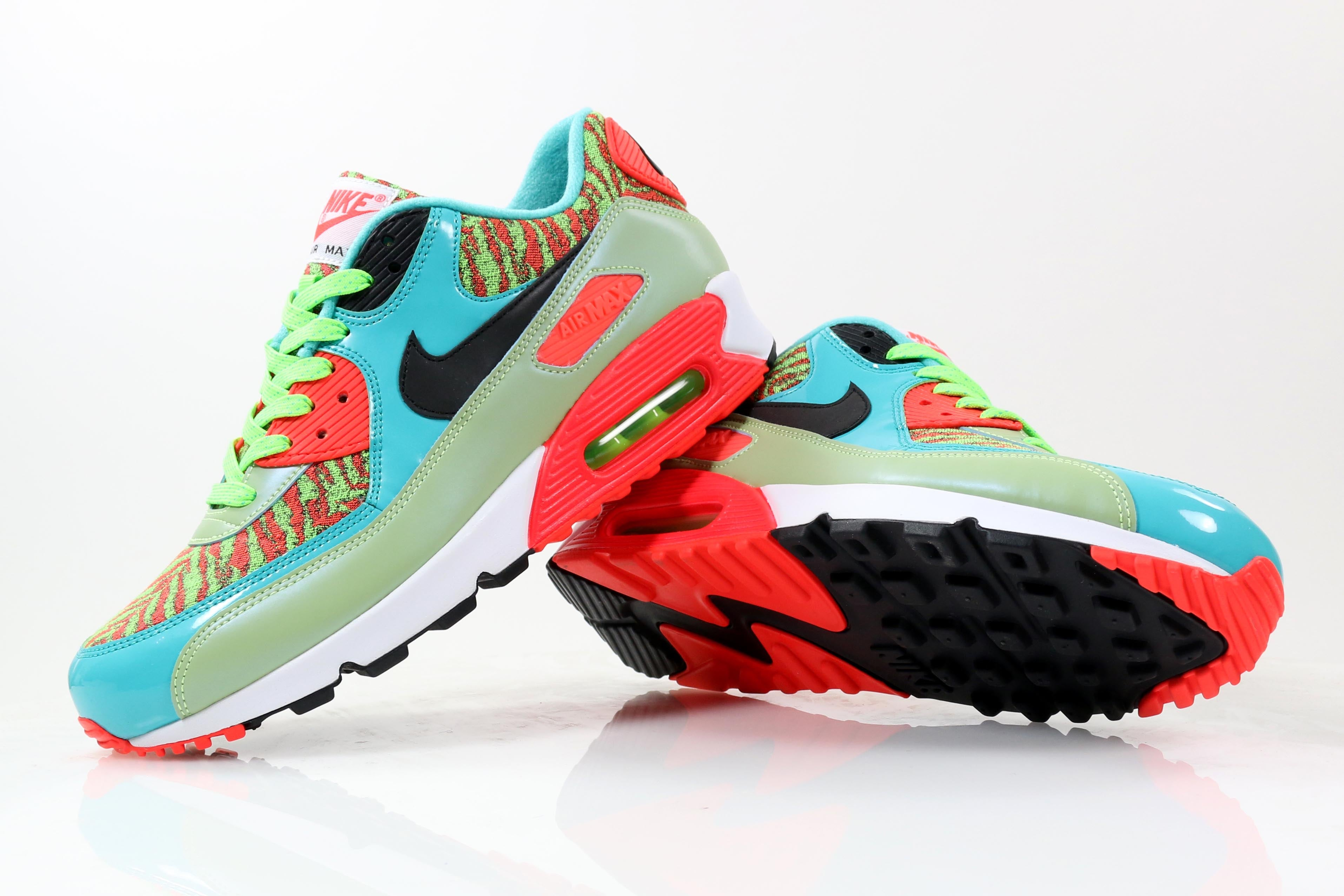 d86da81396f8 Nike continue to celebrate the 25th anniversary of the Air Max 90. This  edition features a vibrant blue and lime green upper with green and orange  tiger ...
