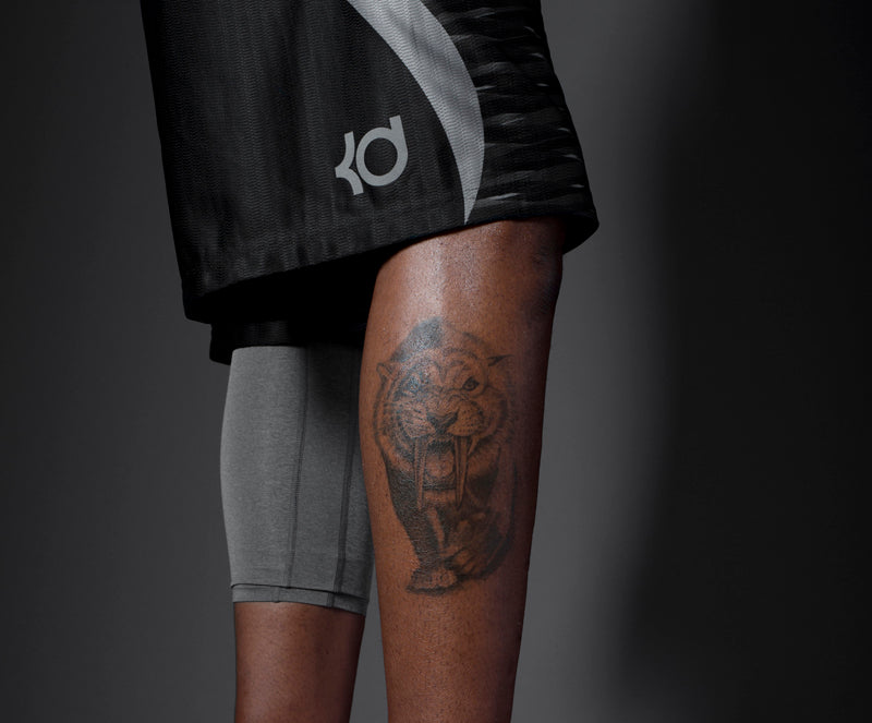 KD leg tattoo shot