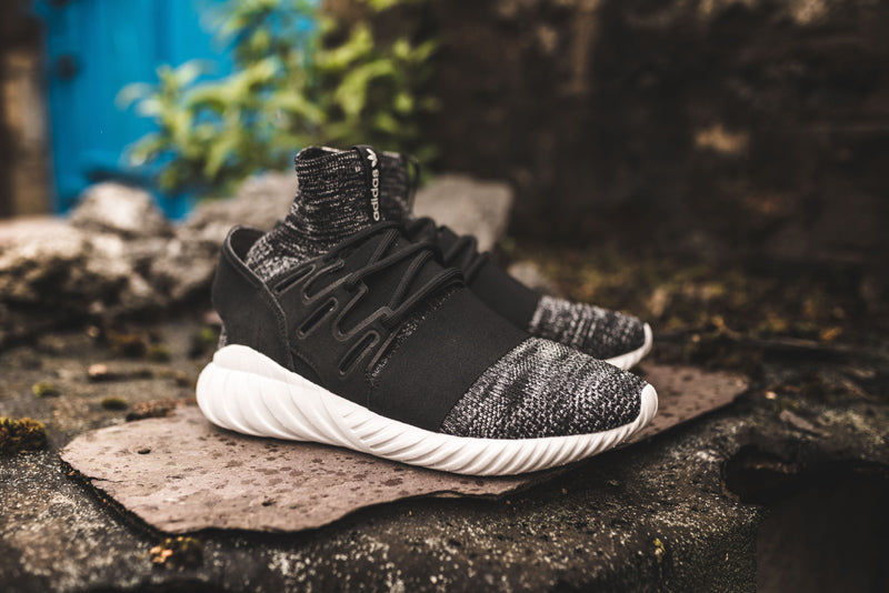fdfdde1a8c05 Built in an ultra-comfy sock-like adidas Primeknit upper that s space-dyed  and woven with a glow-in-the-dark yarn. Adidas Tubular Doom Primeknit GID