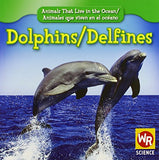 Dolphins/Delfines (Animals That Live in the Ocean/Animales Que Viven En El Oceano (Paperback)) (English and Spanish Edition)