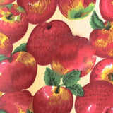 Apple Packed on Beige Poly Cotton Fabric