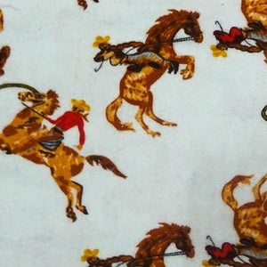 Cowboys on Blue Flannel Cotton Fabric