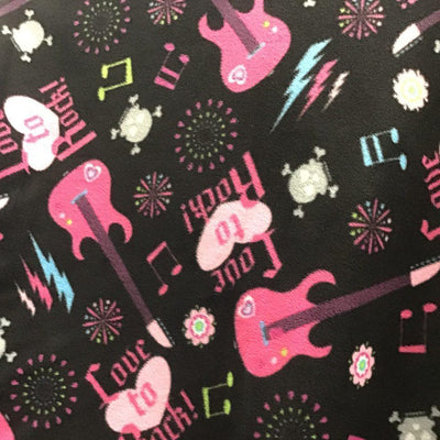 Pink Guitar on Black Anti Pill Fleece Fabric