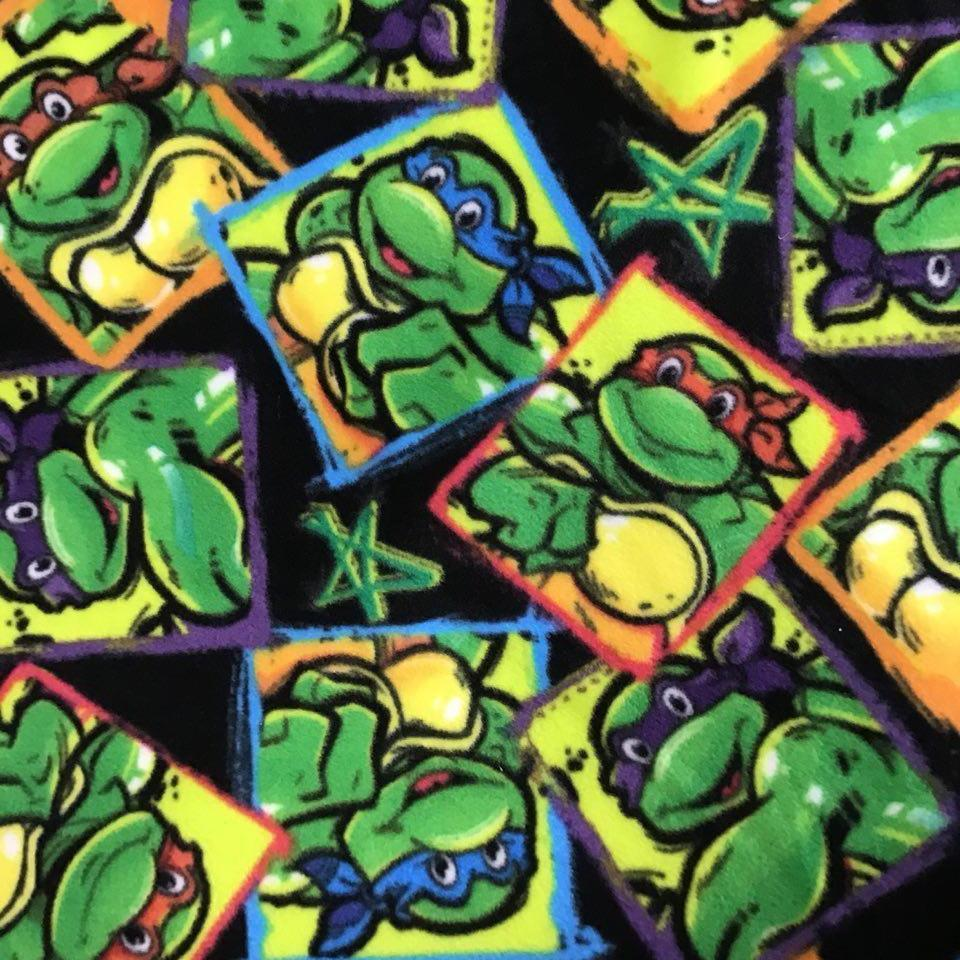 TMNT Ninja Hero on Black Anti Pill Fleece Fabric