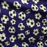 Soccer Balls on Purple Fleece Fabric