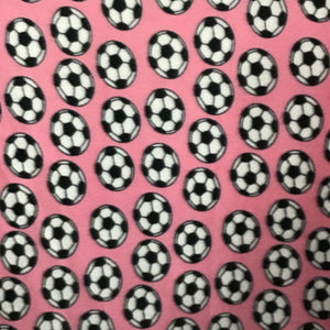 Soccer Balls on Pink Fleece Fabric