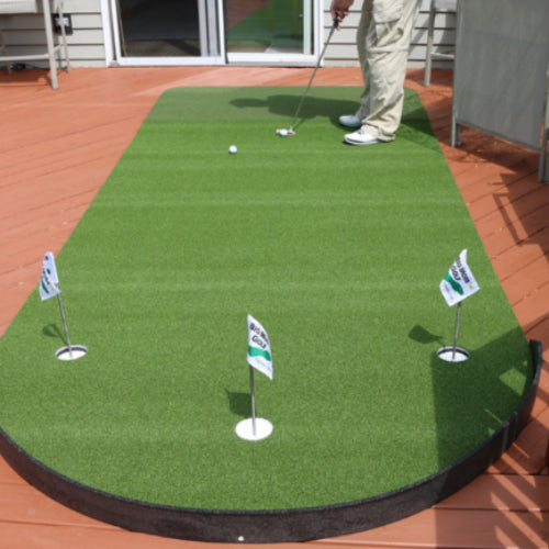 big-moss-putting-green-used-outdoors-on-wood-surface