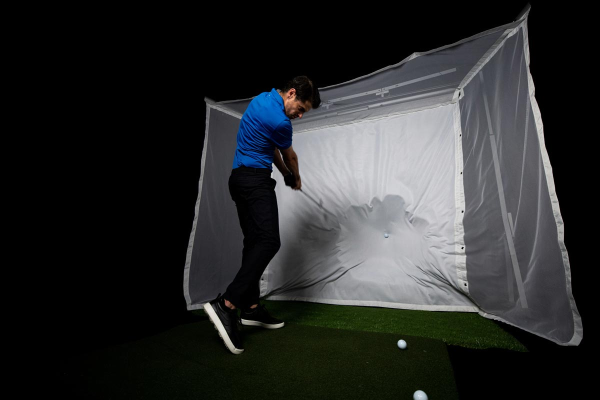 hitting a golf ball on the homecourse retractable ballistic grade screen material