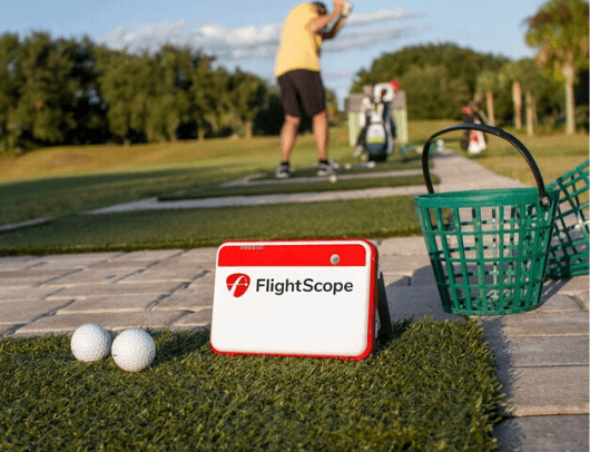 flightscope mevo+ portable size shown on driving range