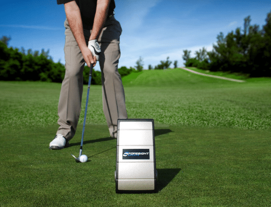 gc2 launch monitor in an outdoor setting at the driving range