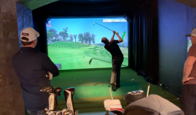 golfers playing on hd golf simulator