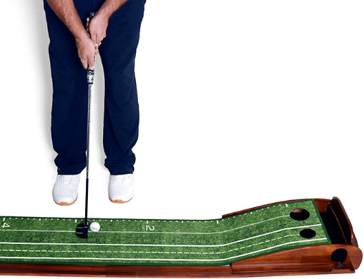 practicing on the perfect practice putting mat