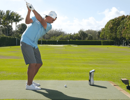 rickie fowler with gcquad launch monitor on the driving range