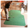 Image of friends playing golf on the Big Moss 6' x 10' Natural Putting Green