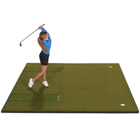 hitting a golf ball off of the fiberbuilt 10 x 10 combo mat with putting green